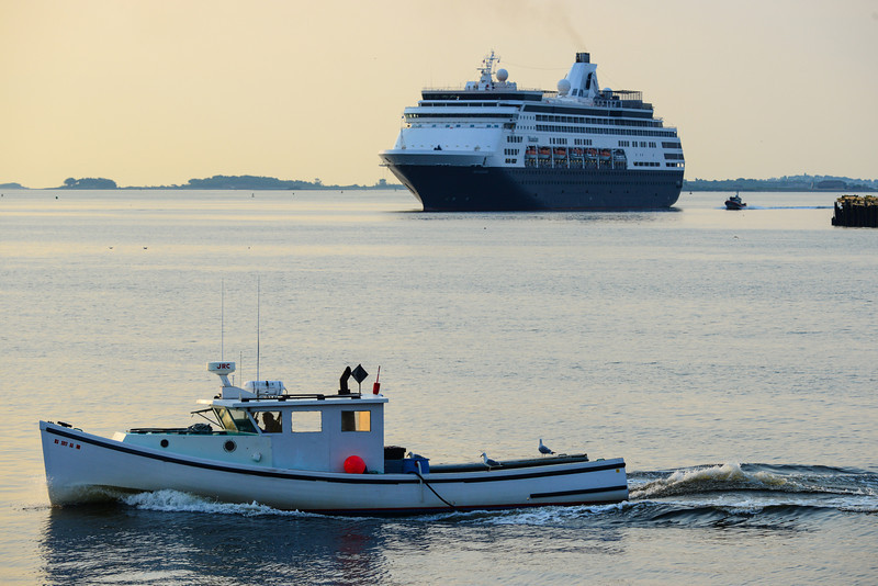 A lobster boat and the cruise ship Maasdam.