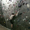 Dyno problem at the Hive Bouldering Gym, Vancouver. November 2014.<br /> Final move starts crunched in from two small finger rails on top of the white blob, there are two tiny sloping knob-lets for feet.<br /> Jump double handed high up and hit a sloping finger jug in dead-point to avoid snapping off.