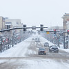 Snow falls as traffic navigates the slush on Christmas Day Thursday morning on Main Street. Sheridan County received between 5 and 7 inches of snowfall making a white Christmas holiday. Justin Sheely|The Sheridan Press.