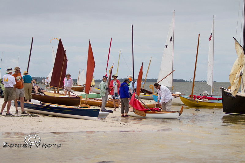 Hard to fit another boat on the beach at Atsenia Otie Key - Cedar Key Small Boat Show - Photo by Pat Bonish