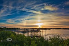 Rainbow around the Sun behind the Low-Key Hideaway - Cedar Key Florida - Photo by Pat Bonish