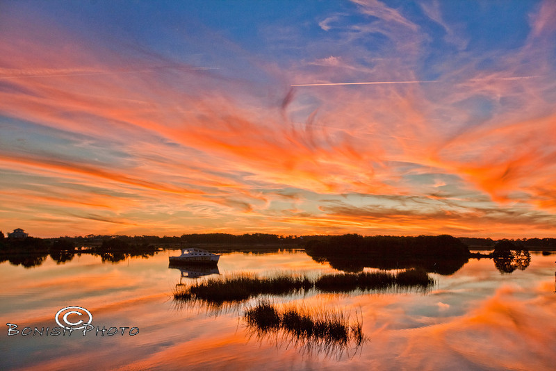 Sunset Reflections behind the Low-Key Hideaway Tiki Bar - Cedar Key Florida - Photo by Pat Bonish