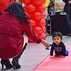 10-month-old Zain Chaudhwy, of Nashua, N.H.is coached to the finish line by his grandmother, Rumpha Chaudhwy. The Diaper Derby was held at the Pheasant Lane Mall on Saturday morning in Nashua, N.H. (SUN/Ashley Green)