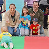 The Lozier Family of Pepperell cheers on little Caitlin during the Diaper Derby at the Pheasant Lane Mall on Saturday morning in Nashua, N.H. From left is mom Michelle, Kaylie, 7, dad Mark, and Dylan, 2. (SUN/Ashley Green)
