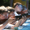 West Wind Cub Scout Day Camp, at the Paul Center in Chelmsford. From left, John Kearns, Matthew Poole, and Conlen Powell, all 9 and from Billerica, shoot at paper bull's eye targets at the BB Range. (SUN/Julia Malakie)