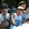 West Wind Cub Scout Day Camp, at the Paul Center in Chelmsford. From left, John Kearns, Matthew Poole, and Conlen Powell, all 9 and from Billerica, get ready to shoot at paper bull's eye targets at the BB Range. (SUN/Julia Malakie)