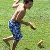 West Wind Cub Scout Day Camp, at the Paul Center in Chelmsford. Sean Newman, 8, of Lowell, dodges wet sponges during the Games activity. (SUN/Julia Malakie)