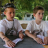 West Wind Cub Scout Day Camp, at the Paul Center in Chelmsford. Dante Pallis, left, and Dylan Carhart, both 7 and from Dunstable, listen to instructions on folding a paper boat at the STEM activity. (SUN/Julia Malakie)