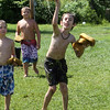 West Wind Cub Scout Day Camp, at the Paul Center in Chelmsford. John Burke, 8 of Wilmington, throws wet sponges during the Games activity. At left front is Sean Newman, 8, of Lowell. (SUN/Julia Malakie)