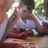 West Wind Cub Scout Day Camp, at the Paul Center in Chelmsford. Aiden Gynan, 7, of Dunstable, studies a math puzzle about squares during the STEM activity.  (SUN/Julia Malakie)