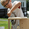 West Wind Cub Scout Day Camp, at the Paul Center in Chelmsford. Almost 200 campers attend the week-long program, with about 50 volunteer Boy Scouts and Girls Scouts helping out with the activities. Nick Vosnakis, 8, of Chelmsford, assembles a treasure chest in Woodworking. (SUN/Julia Malakie)