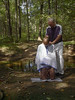 Baptisms in the creek at Camp Men-O-Lan, Sept. 2003