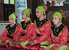 Girls in traditional dress at wedding ceremony, Belitung, Sumatra