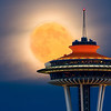 ~Moon Kissing Space Needle~    - www.nitinkansal.com  This is one of those image which i wanted to shoot from a long time. This full moon was perfect opportunity for me with clear skies and clear vantage point.  And this is not Photoshop composite image where you add moon from some other place and space needle from some other place.  Please click on link to help me increase my site ranking: http://tiny.cc/kvomiw  I hope you will like it.