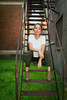 Woman on metal stairs