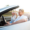 Beautiful couple sitting in their Convertible car.