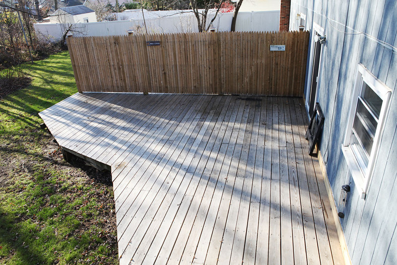 Wooden deck in back yard.  Access from Dining Room or Driveway.