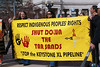 Native Americans hold bright yellow anti KXL pipeline banner.
