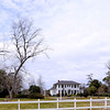 Towles Farmstead  (Goshen Plantation; Plainsfield) The Towles Farmstead is a relatively intact example of an agricultural complex including two early twentieth-century residences illustrating the changing architectural influences of the period, and is associated with the vegetable truck farm industry of Charleston, and with Frank E. and Frank J. Towles, the father and son who managed the farmstead for over seventy years. The farmstead contains two principal residences, the older of which is a one-story, frame house constructed ca. 1903, with characteristic Neo-Classical and Bungalow features. The house has a square core shape and a low-pitched, bell-cast hip roof which extends over a wraparound porch on the east, north and south elevations. The walls are finished with weatherboard and the roof is clad with composition shingles. Two chimneys which rise from the rear slope are of stuccoed brick with corbeled caps, and the foundation is of stuccoed masonry. The full-façade porch features Tuscan columns and square balusters. The second residence is a two-story frame house constructed in 1930, with characteristic Colonial Revival and Italian Renaissance features. The house has a rectangular core shape with one-story wings at the side elevations and a clay tile-clad roof, with carved wooden brackets at the roof of the main body, and a projecting entrance porch supported by two slender Tuscan columns. Both houses feature a variety of contributing utility outbuildings. Listed in the National Register January 21, 1994.