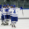 Ben Chwick, Geoff Sullivan, Nick Lanza, and Alex Walsh, of Colby College, in a NCAA Division III hockey game against Tufts University on December 6, 2013 in Waterville, ME. (Dustin Satloff/Colby College Athletics)