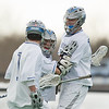 Alex Rutan and Austin Sayre celebrate Rutan's goal during the second half of a NCAA Division III men's lacrosse game against at Hamilton College on March 8, 2014 in Waterville, ME. (Dustin Satloff/Colby Athletics)
