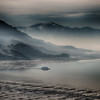 Day's haze from industry on the Great Salt Lake; Antelope Island.