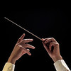 Orchestra Conductor directing a symphony