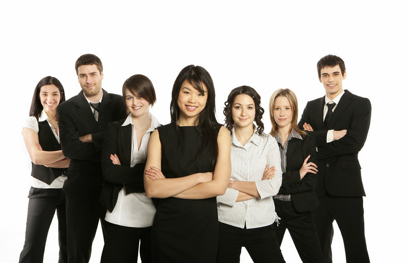 Group of young and confident businessmen and women professionally dressed.