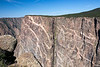 Painted Wall, tallest (2250') sheer cliff in Colorado.  Lighter-colored pegmatite dikes visible.  Black Canyon of the Gunnison National Park.  Near Montrose, Colorado.  7118' elevation.