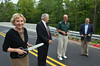 Officials, from left, Lynn Bush, Bucks County Planning Commission,  State Representative Paul Clymer, Dave Nyman, Chairman,  East Rockhill Township Board of Supervisors, and Jim Nietupski, East Rockhill Township Supervisor, following the ribbon cutting for North Rockhill Road bridge in East Rockhill Township.   Friday, August 1, 2014.   Photo by Geoff Patton