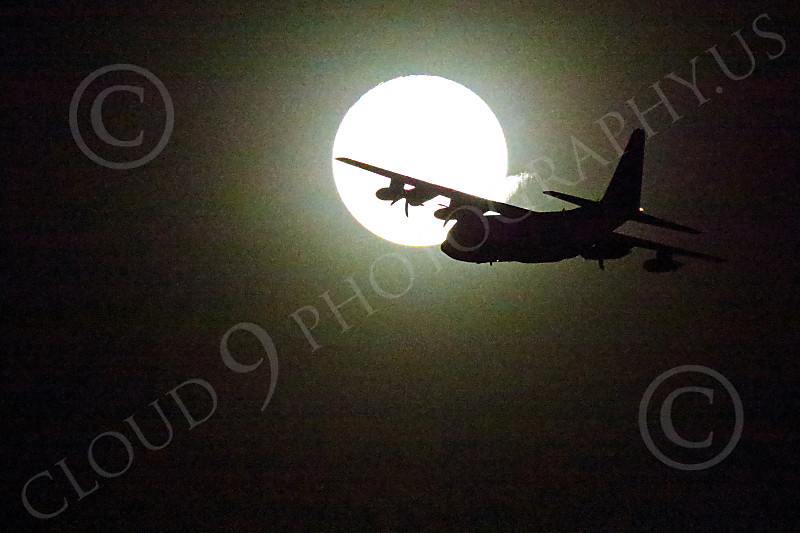 WWAN 00014 A Lockheed C-130 Hercules USAF cargo aircraft flies in front of the moon during a Red Flag mission out of Nellis AFB military airplane picture by Peter J Mancus