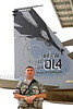 ACM 00133 A California ANG senior non-commissioned officer stands by the tail of his squadron's commanding officer's airplane at Fresno ANG base 3-2015 military airplane picture by Peter J Mancus