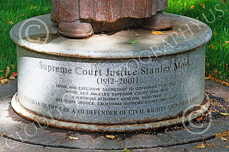 STY-JSMosk 00004 Base with text for statue of California Supreme Court judge Stanley Mosk who championed unconstitutional elitist anti-Second Amendment individual right to firearm laws, statue picture by Peter J Mancus