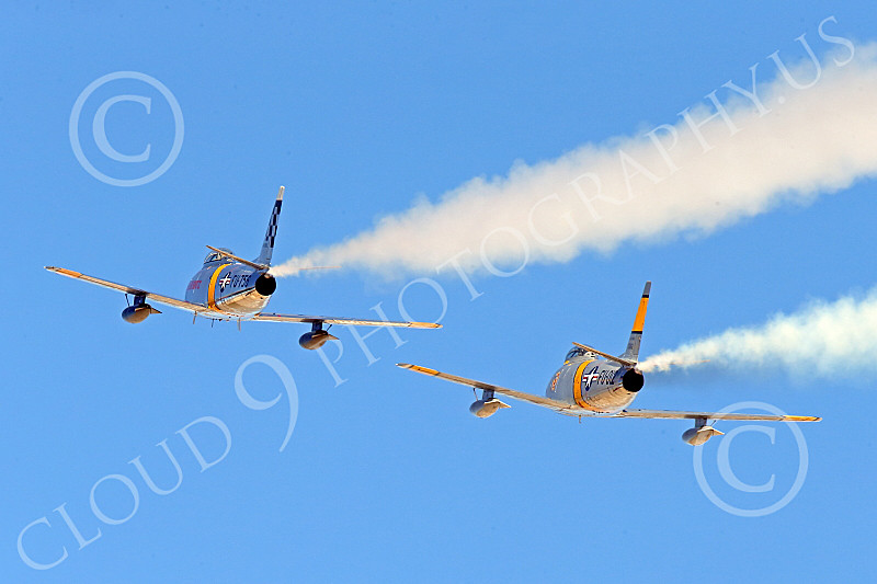 WB-F-86 00104 Two North American Sabre USAF Korean War era jet fighters zoom up, warbird picture by Peter J Mancus