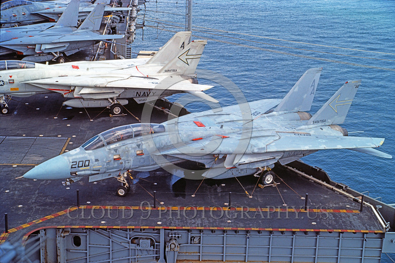 F-14USN-VF-103 0023 A static Grumman F-14 Tomcat USN VF-103 JOLLY ROGERS on the USS Saratoga, 9-1984 military airplane picture by Gilbert Hanson