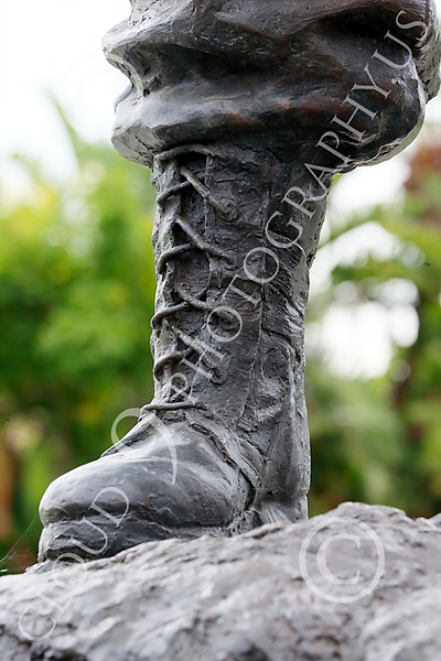 STY-VIETNWM 00063 Close up of a booted foot for a soldier on depicted in a Vietnam War Memorial statue picture by Peter J Mancus