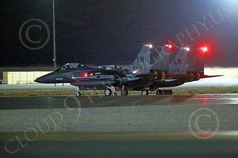 F-15USAF 00831 Two static LN code USAF McDonnell Douglas F-15E Strike Eagles wait to take off on a night Red Flag mission at Nellis AFB 7-2014 military airplane picture by Peter J Mancus