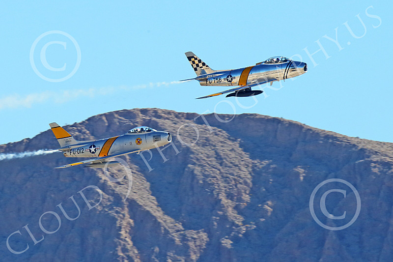 WB-F-86 00106 Two North American Sabre USAF Korean War era jet fighters fly in formation, warbird picture by Peter J Mancus