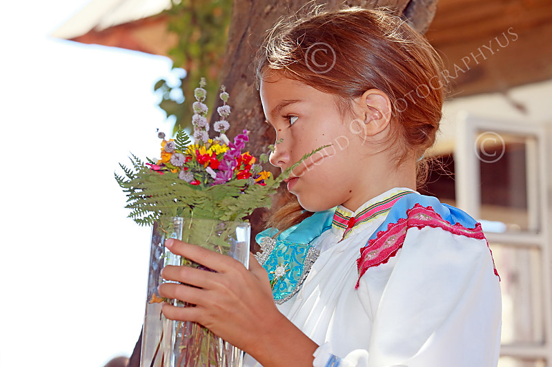 HR-FtRossRUSS 00098 A young civilian girl Russian settlor re-enactor holds a vase of flowers at Ft Ross California historial picture by Peter J Mancus
