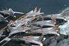 F-14USN-VF-1 0021 A dense pack of static USN Grumman F-14 Tomcats VF-1 WOLFPACK on stern flight deck of an aircraft carrier 10-1974 military airplane picture by Robert L Lawson