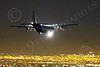 WWAN 00017 A Lockheed C-130 Hercules USAF lands at Nellis AFB during a night Red Flag training exercise military airplane picture by Peter J Mancus