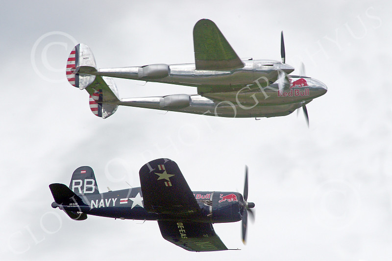 WB-Lockheed P-38 Lightning 00094 A Red Bull Lockheed P-38 Lightning flies with a Red Bull Vought F4U Corsair warbird picture by Stephen W D Wolf