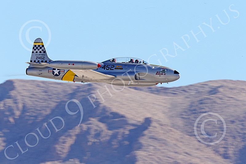 WB-T-33 00020 A flying Lockheed T-33 Shooting Star USAF jet trainer, ACE MAKER II, makes a low high speed pass, warbird picture by Peter J Mancus