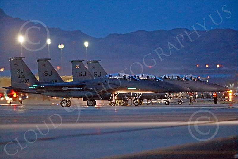 F-15EUSAF 00805 Three static SJ code USAF McDonnell Douglas F-15E Strike Eagles at EOR for a night Red Flag mission at Nellis AFB 7-2014 military airplane picture by Peter J Mancus