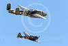WB-B-25 00138 Former enemies fly peacefully together--a North American B-25 Mitchell US Army Air Corps World War II medium bomber and a Japanese Zero fighter, warbird picture by Peter J Mancus
