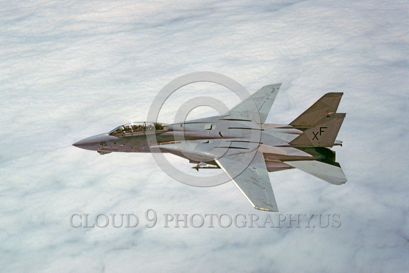 F-14USN-VX-4 0002 A Grumman F-14 Tomcat USN jet fighter VX-4 THE EVALUATORS XF code flying above clouds military airplane picture by Peter J Mancus