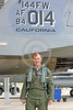 ACM 00099 A California ANG F-15 Eagle jet figher pilot stands by the tail of his large jet fighter, by Peter J Mancus