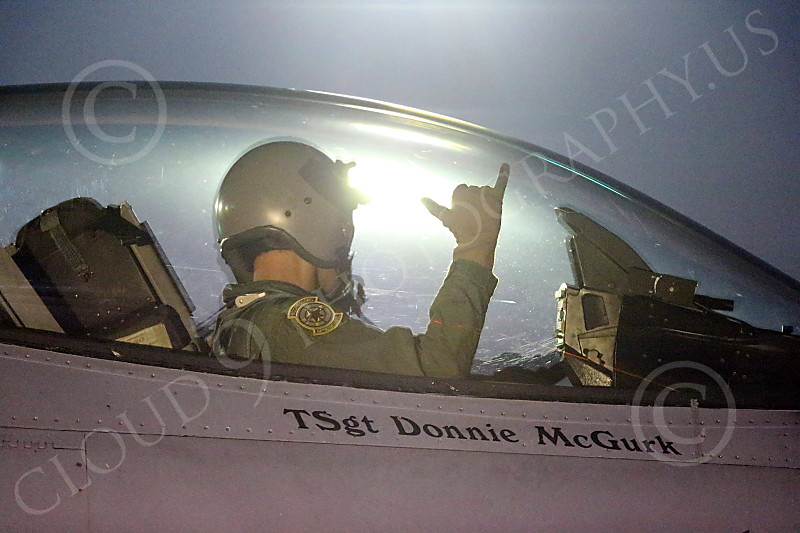 ACM 00363 A USAF F-16 Viper pilot in his cockpit for a night Red Flag training mission at EOR signals ground crew Nellis AFB 7-2014 military airplane picture by Peter J Mancus