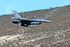 MLLF 00019 A Lockheed Martin F-16 Fighting Falcon USAF jet fighter 85551, ED code, flies low over a ridge line into a canyon on a training mission, military airplane picture by Peter J Mancus