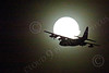 WWAN 00029 A Lockheed C-130 Hercules USAF cargo aircraft flies in front of the moon during a Red Flag mission out of Nellis AFB military airplane picture by Peter J Mancus